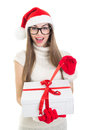 Cute teenage girl opening christmas present happy caucasian wearing santa claus hat and gloves smiling looking at camera wearing Royalty Free Stock Photo