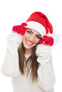Cute teenage girl posing wearing santa claus hat and gloves pretty happy beanie looking at camera smiling isolated on white Royalty Free Stock Photography