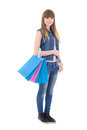 Cute teenage girl with shopping bags isolated on white background Stock Photo