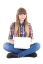 Cute teenage girl sitting with laptop isolated on white background Stock Images
