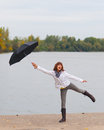 Cute teenage girl with umbrella enjoy cloudy day Royalty Free Stock Photo