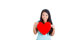 A cute teenager holding a red heart for her crush love and valentines day woman smiling adorable beautiful young woman isolated on Stock Photos