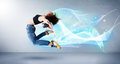 Cute teenager jumping with abstract blue scarf around her Royalty Free Stock Photo