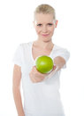 Cute teenager offering green apple Stock Photography