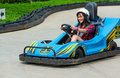 Cute thai girl is driving go kart with speed in the race course Royalty Free Stock Images