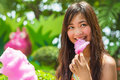 Cute thai girl is eating pink candyfloss with joy Royalty Free Stock Photos
