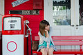 Cute Thai girl is waiting on the bench Royalty Free Stock Photography