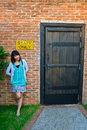 Cute Thai woman is standing outside the staff room Royalty Free Stock Photos
