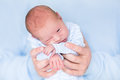 Cute tiny newborn baby boy in his father s hands sleeping Royalty Free Stock Image