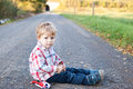 Cute toddler on autumn landscape Royalty Free Stock Photos