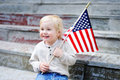 Cute toddler boy holding american flag Royalty Free Stock Photo
