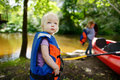 Cute toddler girl getting ready for kayaking with her parent Stock Photography