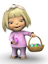 Cute toddler girl holding easter egg a wearing pink clothes smiling and an in one hand and a basket full of eggs in the Stock Image