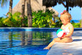 Cute toddler girl playing with ball in swimming Royalty Free Stock Photo