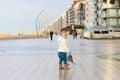 Cute toddler girl walking on winter promenade Royalty Free Stock Photo