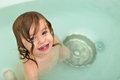 Cute Toddler Giving Toothy Smile from the Bath Tub Stock Photography