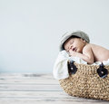Cute tot sleeping in a basket