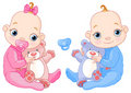 Cute twins with toys Royalty Free Stock Photo