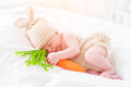 Cute two weeks old newborn baby boy wearing knitted bunny costume
