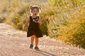 image photo : Cute two-year-old girl running outdoors