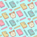 Cute vector seamless pattern with notebook, alarm clock etc. School elements, childish background. Royalty Free Stock Photo