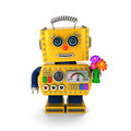 Cute vintage robot sending a get well wish yellow toy with flower bouquet over white background Royalty Free Stock Images