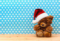 Cute vintage teddy bear with santa hat retro christmas decoration Stock Images