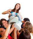 Cute winner girl team celebrating picked up in the air Royalty Free Stock Photography