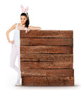 Cute woman with bunny ears holding a white blank sign large Royalty Free Stock Photo