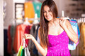 Cute woman doing some shopping beautiful happy girl carrying bags at a clothing store and smiling Royalty Free Stock Photos