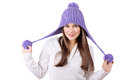 Cute woman with fashionable purple winter knitted hat caucasian brunette wearing smiling looking at camera isolated on white Royalty Free Stock Photo