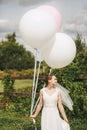 Cute Woman Holding Big Balloon...