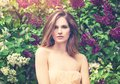Cute Woman On Lilac Flowers An...