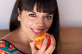 Cute woman with a nectarine closeup of young holding fresh Stock Image