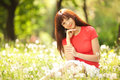 Cute woman in the park with dandelions Royalty Free Stock Photo