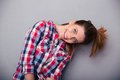 Cute woman with ponytail looking at camera funny over gray background Royalty Free Stock Images