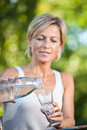 Cute woman pouring water in a glass