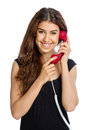 Cute woman with red wired phone on white background Stock Photography
