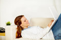 Cute woman smiling and working on laptop Royalty Free Stock Photography