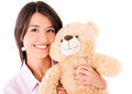 Cute woman with a teddy bear holding isolated over white background Royalty Free Stock Images