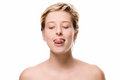 Cute woman trying to reach her nose with her tongue on white background Royalty Free Stock Photos