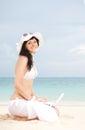 Cute woman white laptop summer beach Stock Photo