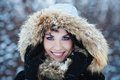 Cute woman in winter park portrait of a Royalty Free Stock Image