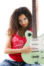 Cute women in red with electric guitar Stock Photos