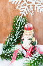 Cute wooden Santa claus standing in snow Royalty Free Stock Photo