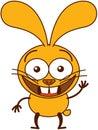 Cute yellow bunny waving