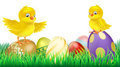 Cute yellow chicks on Easter eggs Royalty Free Stock Images