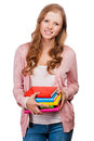 Cute young attractive student girl holding colorful exercise books Stock Photo