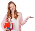 Cute young attractive student girl holding colorful exercise books. Royalty Free Stock Photo