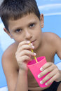 Cute young boy drink juice Stock Photography